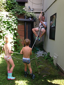 Peter's solution to reaching the high windows in our house: rope up. Worked! And of course the kids loved it.