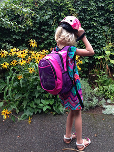 Amelia suiting up to scoot to her first day of 1st grade at Lawton.