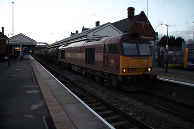 60065 1600/6D42 Eggborough-Lindsey passes Scunthorpe station in fading light.