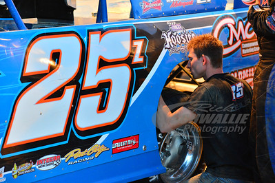 Austin Hargrove works on Mason Zeigler's car