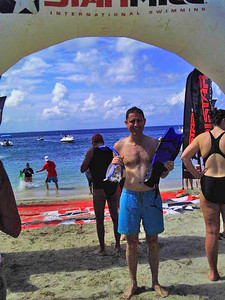 Each year there is a swimming race from Nevis to St Kitts - 2.5 miles across the open sea, shepherded by sea kayaks. My new colleagues were competing shortly after I arrived, and I felt peer-pressured to join. After all, they were women, and being a bloke I couldn't chicken out... it was brilliant and amazing. There were points from which I couldn't see land (due to the swell). We drifted in all directions but eventually made it across. There were big rays and other interesting wildlife, but the hammerhead shark seen 2 years ago (and always in the back of my mind) never appeared. Here I've just arrived on St Kitts. The next competitor is emerging from the water behind me.