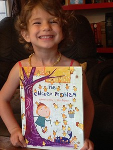 Children's author and director Jennifer Oxley signed and doodled her book, The Chicken Problem, as a gift for Craig's niece's third birthday.  Here's Shai with her gift, which she loved.