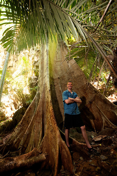 Eric stands proudly dwarfed by a jungle giant.