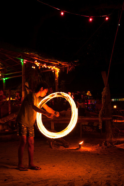 A fire dancer practices some routines in the late evening darkness on Tonsai Beach.