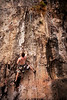 Paul works his way higher on <i>Short and Savage 6B+</i> at the One-Two-Three wall on East Railay Beach.