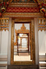 Gilded doorways decorate the architecture of Wat Pho in Bangkok.