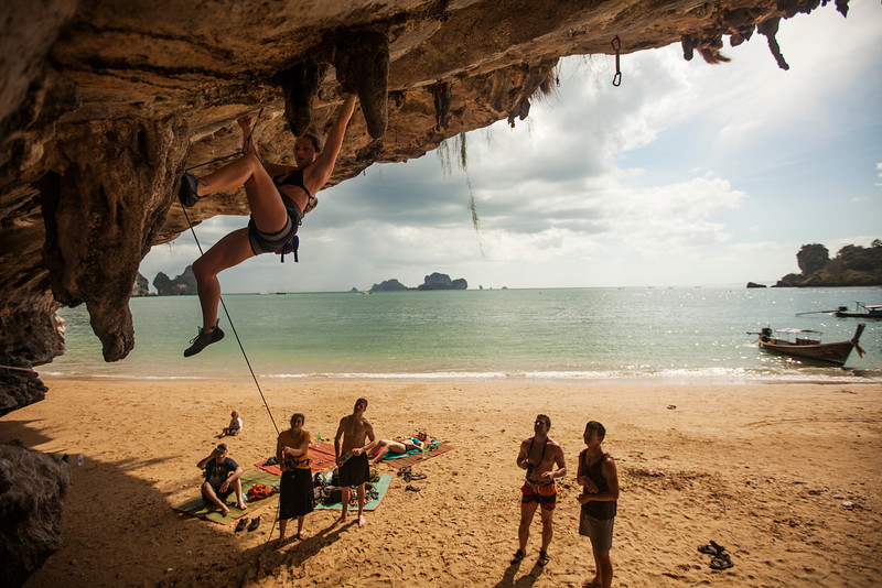 With the Andaman Sea lapping gently behind, Emily cranks into the roof on a route on Tonsai Beach.