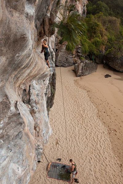Misty nears the high crux of <i>Pahn Taalod (Always Pass) 6a</i> only feet from the ocean in the tropical paradise of Tonsai Beach.