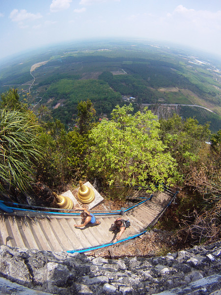 Paul and Misty finish the last of the 1237 steps to the Tiger Cave Temple in Krabi, Thailand.