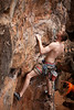 Eric takes care of leading <i>Long Doo 5</i> at the Escher World wall on Phra Nang Beach.