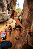 Emily searches for holds on her way up <i>Be careful 6B+</i> at the One-Two-Three wall on East Railay Beach.
