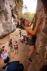 Misty climbs <i>Be careful 6B+</i> at the One-Two-Three wall on East Railay Beach as the group hangs out below.