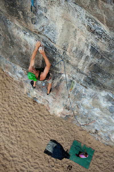 Eric works through the moves on <i>Rod Yaak (Difficult to Pass) 6a</i> in the early morning shade on Tonsai Beach.