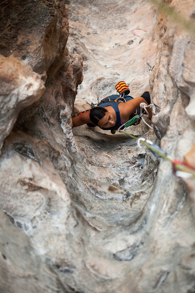 Alex works her way up <i>Groove Tube 6a</i> on the Fire Wall at Tonsai Beach.