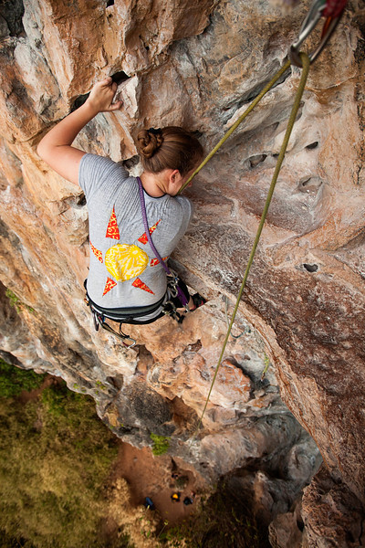 Tracy finds her way up <i>Groove Tube 6a</i> on the Fire Wall at Tonsai Beach.