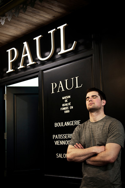 Paul stands proud in front of his restaurant at the airport in Dubai.