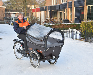A delivery bike put to good use to deliver the post through all weathers.