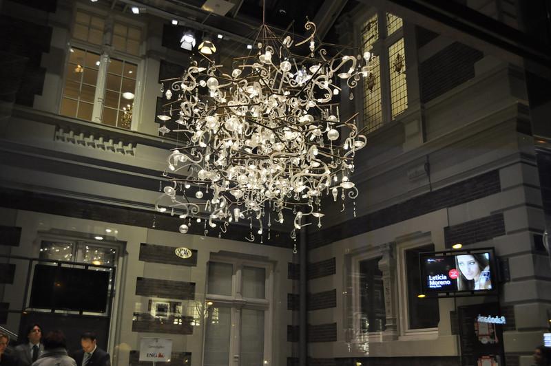 A fancy glass chandelier in a hotel downtown