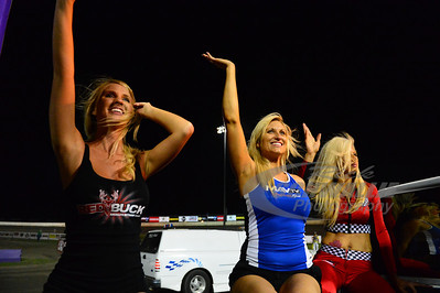 Red Buck Model Missy Orr waves to the crowd along with MavTV Model Sacha Sturgill and Tri-City Speedway Model