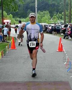 Craig crosses the finish line (photo by Annapolis Triathlon Club)