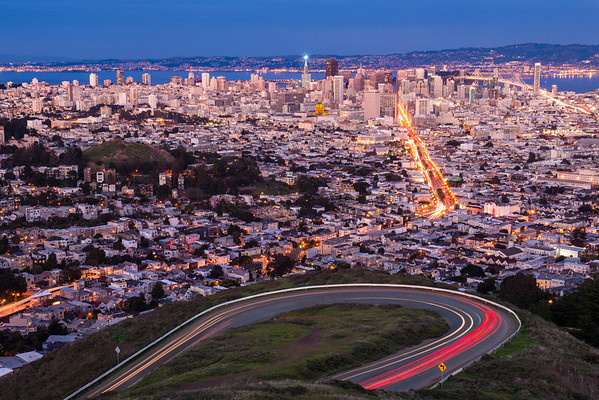 The city of San Francisco decked itself out in 49er colors during their first playoff game. Cars drive around the road to Twin Peaks and the Beacon is lit on top of the Transamerica Building. Notice the colors of Coit Tower and City Hall (and you can make out some more colors of the Embrcadero Center buildigns)