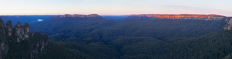 Panorama view of the Three Sisters and the surrounding scene at dawn, as seen from Echo Point in winter.
