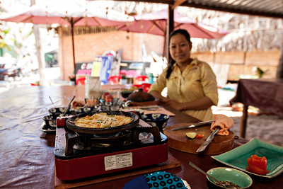 Aurora, I was thinking of you and wishing you were there to take this cooking class with me! Such a cute little Vietnamese lady, I loved her! Here is she teaching me to make shrimp pancakes. :) The Mui Ne Cooking School is awesome. Loved it.