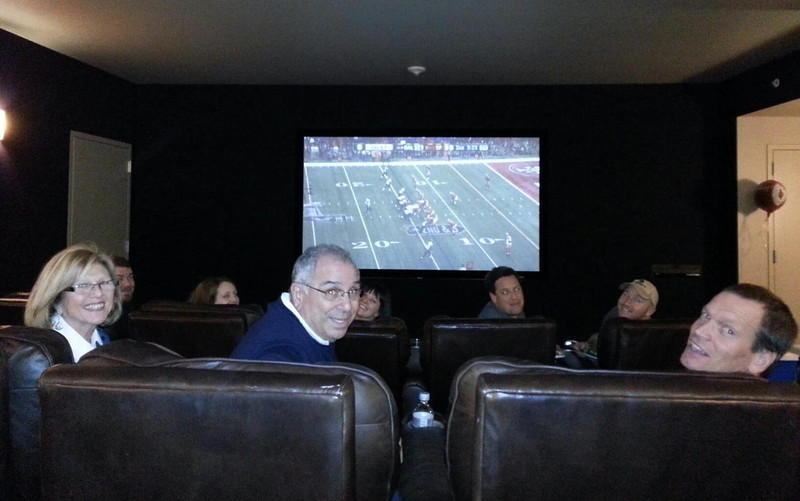 Enjoying the Superbowl at the Clements' big screen theater room