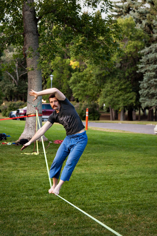 John keeps his balance as the 90 foot slackline bounces a little more elastically than we are used to.