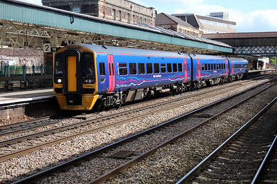 158952 departs Newport for Cardiff.