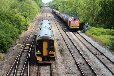 158953 over takes 60015 at 1320/6B33 Theale-Roberston at Llanwern West Junction.