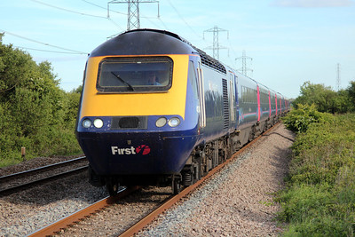 A FGW HST passes the foot crossing at Margam.