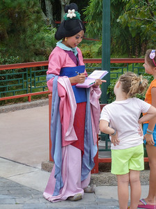 Mulan gives an autograph
