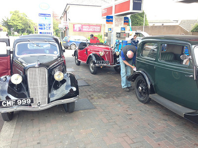 The cars need a drink on the outskirts of Cheltenham