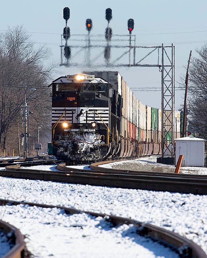 NS intermodal train 203 rolls under the signals at 11th Street in Salisbury,NC.