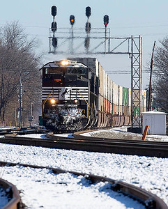 NS intermodal train 203 rolls under the signals at 11th Street in Salisbury,NC.