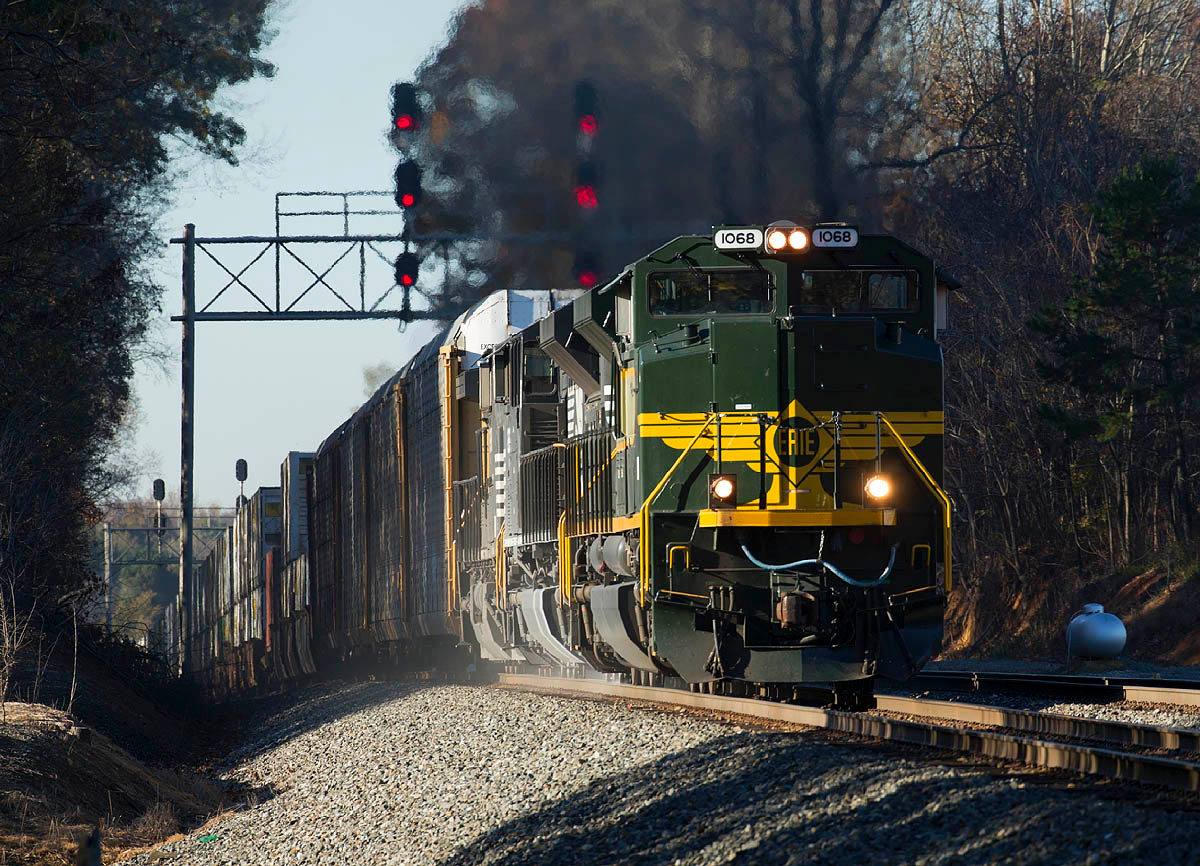 NS #1068 Erie RR Heritage Motor leads train 214 under the signals at CP Sharp in Linwood.