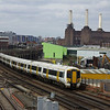 375827+375813 pass Wandsworth Road station in the shadow on the iconic and derelict Battersea Power Station 22/04/13