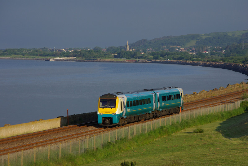 175004 passes Pwll between Burry Port and Llanelli working the 06:15 Carmarthen - Manchester Pic 10/06/13