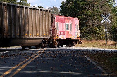 Little pink caboose on the rear of NS train PL90 on the Duke Power Buck Steam Plant lead Spencer,NC