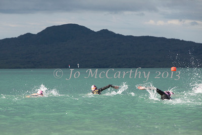 Women swim out to first buoy with Rangitoto Island in background. Race 1 of Stroke and Stride 2013/2014 series, Mission Bay, Auckland, New Zealand. Thursday 14 November 2013.