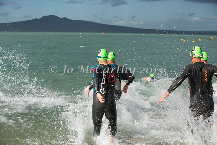 Competitors enter the water in the men's division,  Race 2 - 2013/2014 Stroke and Stride swimrun series. Mission Bay, Auckland, New Zealand. Thursday 28 November 2013. Photo: Jo McCarthy