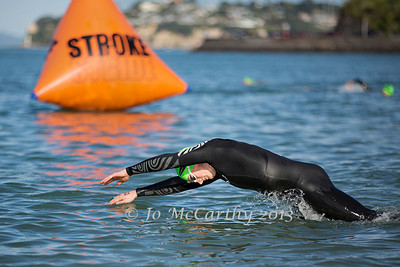 A competitor warms up ahead of Race 3 of the 2013/2014 Stroke and Stride swimrun series. Mission Bay, Auckland, New Zealand, Thursday 12 December 2013.  Photo: Jo McCarthy