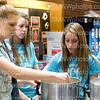 "Senior Taylor Bonser stirs cappacino mix with senior Gaby Riggs and junior Korbyn Caswell on Feb. 27 in the mall. CCC students worked the cappuccino stand to raise money for junior, Delaney Mirocke's older sister, Lauren Mirocke's, medical bills. Lauren was diagnosed with acute leukemia. ""I look forward to cappuccino day more than any other day in school. I am around some of my favorite people and we all work so well together. I love being on executive board and it is so fun to see everyone in school supporting such a good cause."" Bonser said."