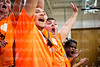 Senior Logan Miller yells as the cougars made a layup on Feb. 21 in the Main Gym. There was an orange-out, where the student body was told to wear orange to show their school pride.