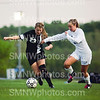 Junior _______ defends the ball against Blue Valley North on May 14 at DAC-Switzer. The lady cougars won the match 2-1.
