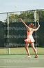 Senior Gabby Whitmore serves the ball on September 11th, 2013 at Shawnee Mission Northwest. The girls varisty tennis team played Olathe East on Wednesday.