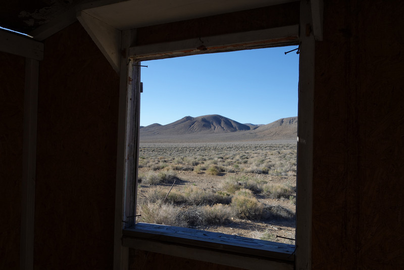 Looking out of one of the shacks.