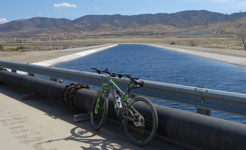 This is the California Aqueduct, which drains water from the Sierras to southern California.  Most areas are about 40 feet wide and 30 feet deep.  It's truly an oasis in the desert.