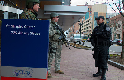 041613, Boston, MA - Members of the Framingham, Silverlake and Metro SWAT teams stand guard outside Boston Medical Center's Shapiro Center. Photo by Ryan Hutton